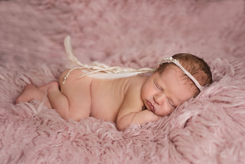 Suffolk essex newborn photographer baby wearing dreamcatcher halo