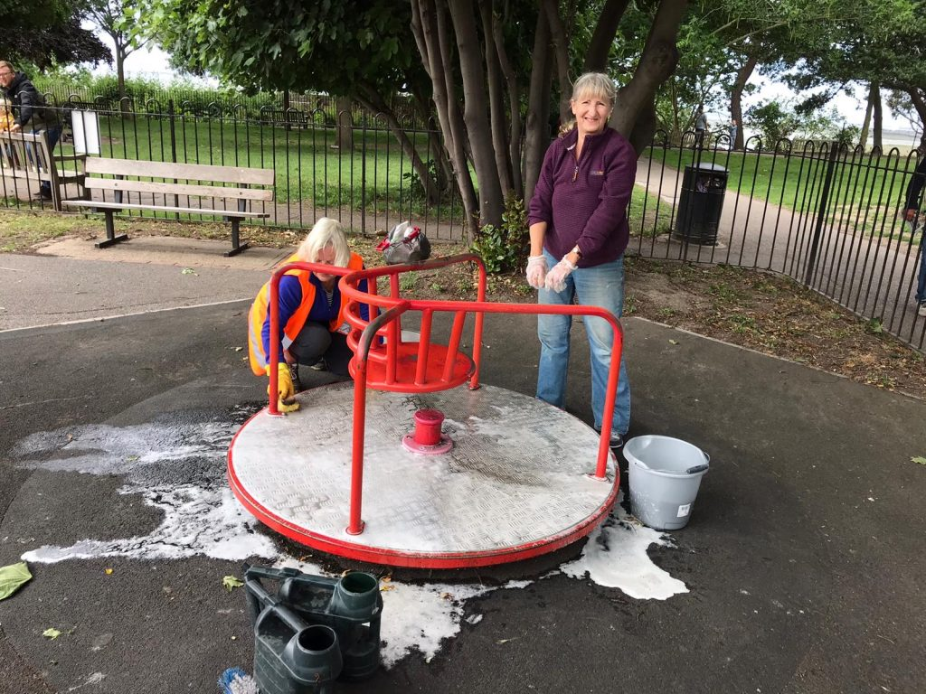 Friends of Leigh Library Gardens paint the playground